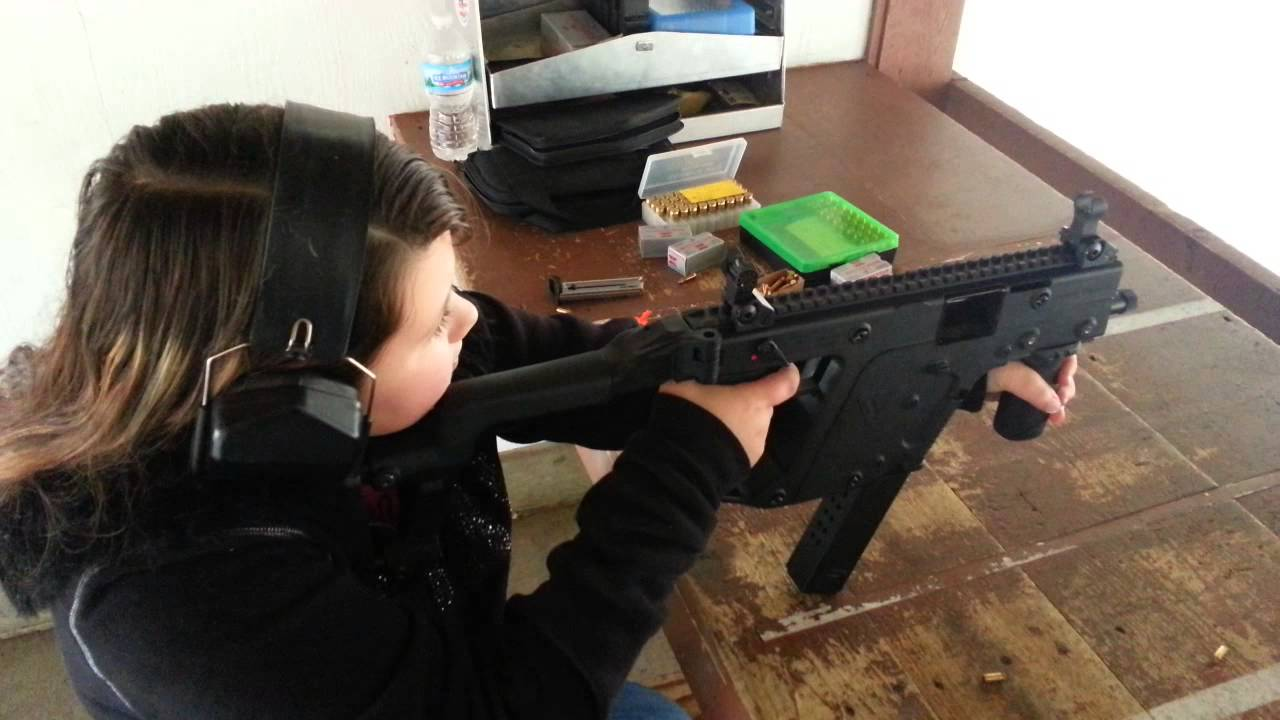 10yr old girl shooting a Kriss Vector 45acp