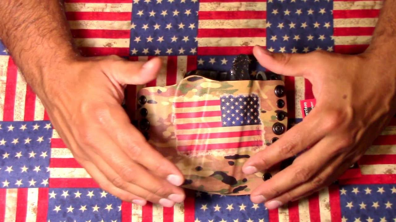 Outside the waistband holster: Courage Holsters by TST survival.
