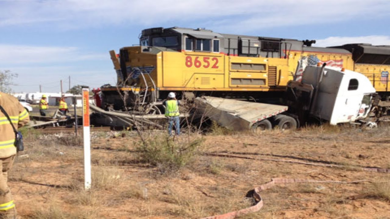 Train destroys truck loaded with oil field pi