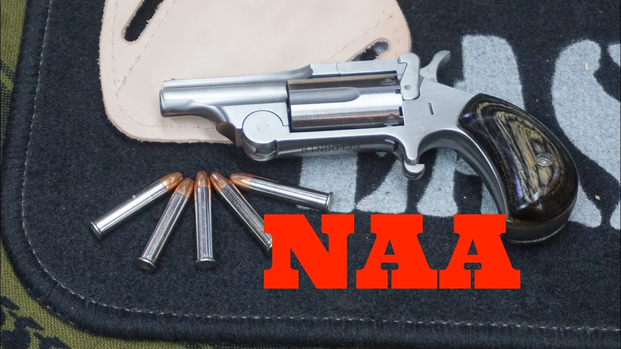 A pair of NAA mini 22 pistols, old & new