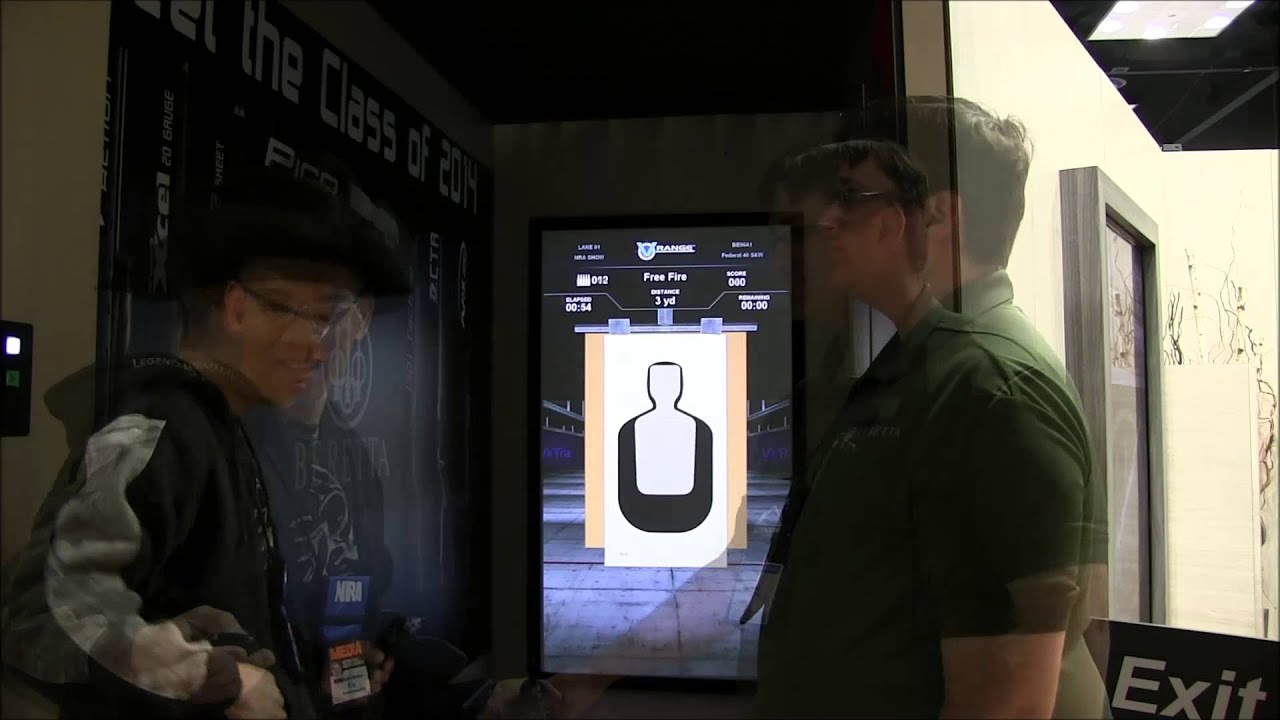 2014 National Rifle Association Annual Meetings and Exhibits Beretta Movie Poster and Pistol Simulat