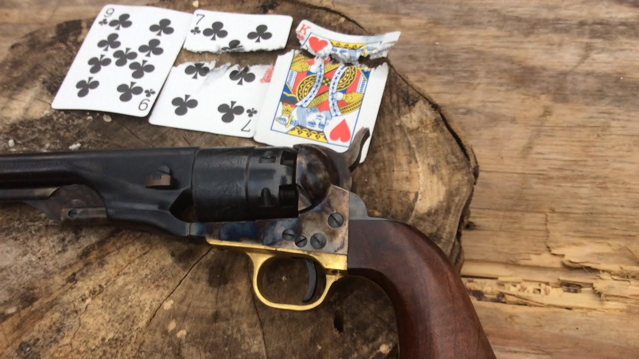 Splitting some playing cards with a 1860 Colt revolver reproduction by Pietta