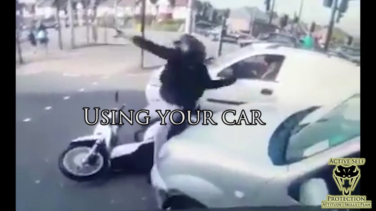 Moto Carjackers Stopped by Bystander   Active Self Protection