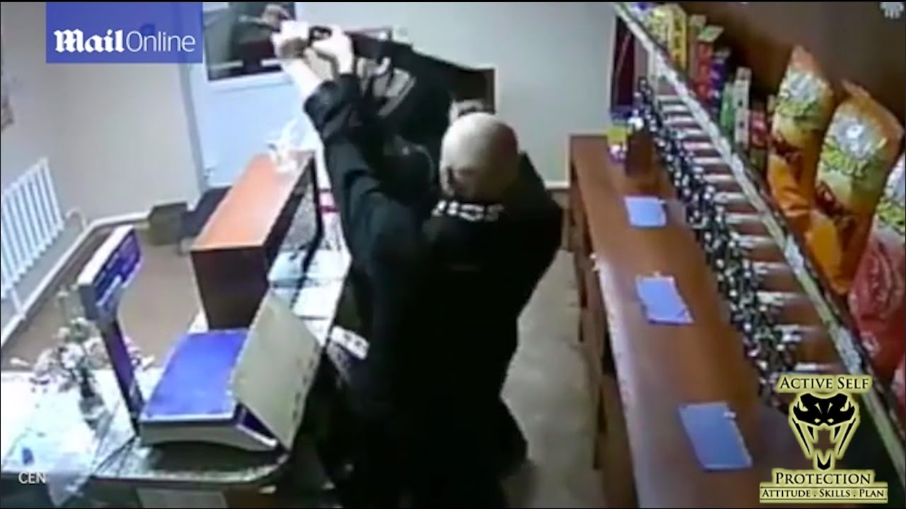 Woman Fights Rifle Wielding Armed Robber