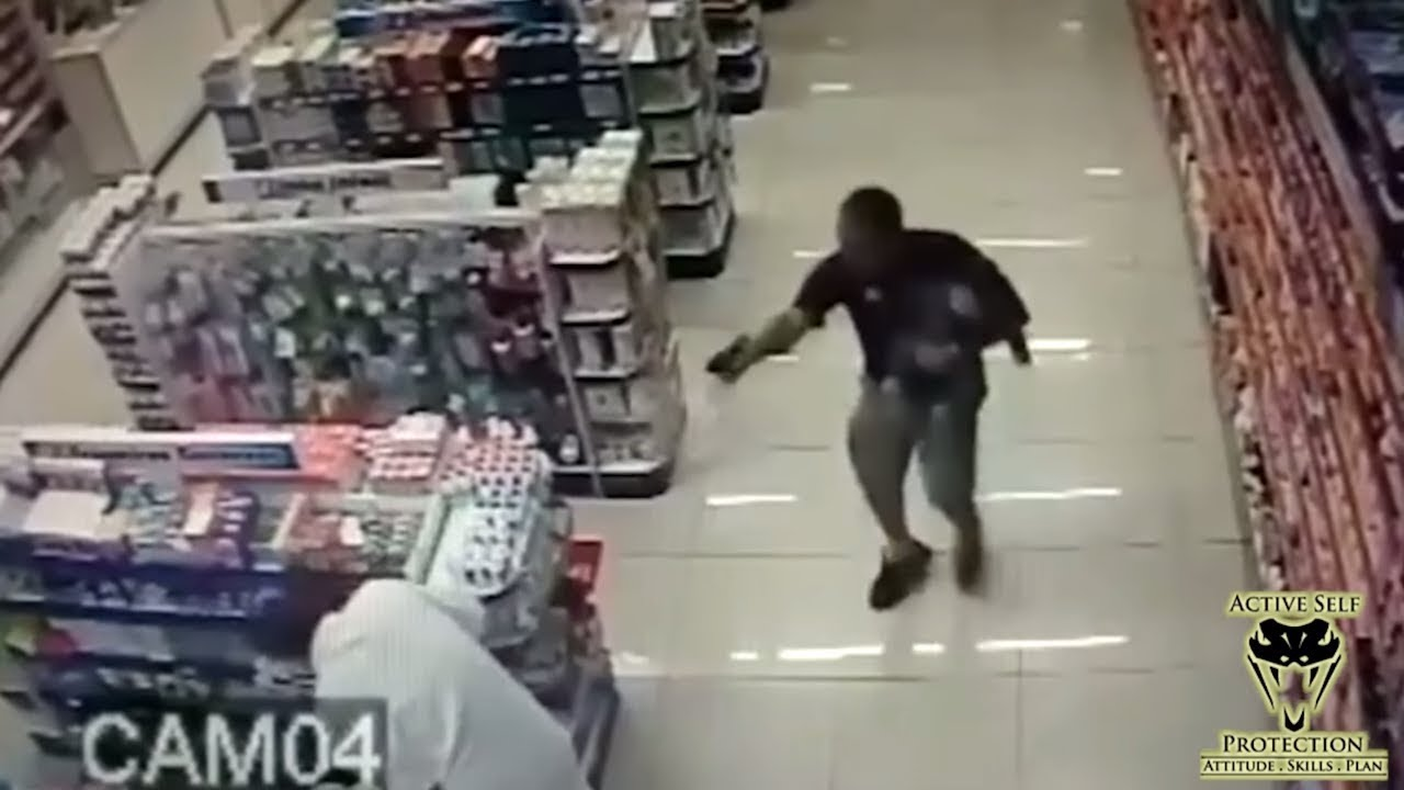 Off Duty Cop Holding His Son Takes Out Robbers   Active Self Protection