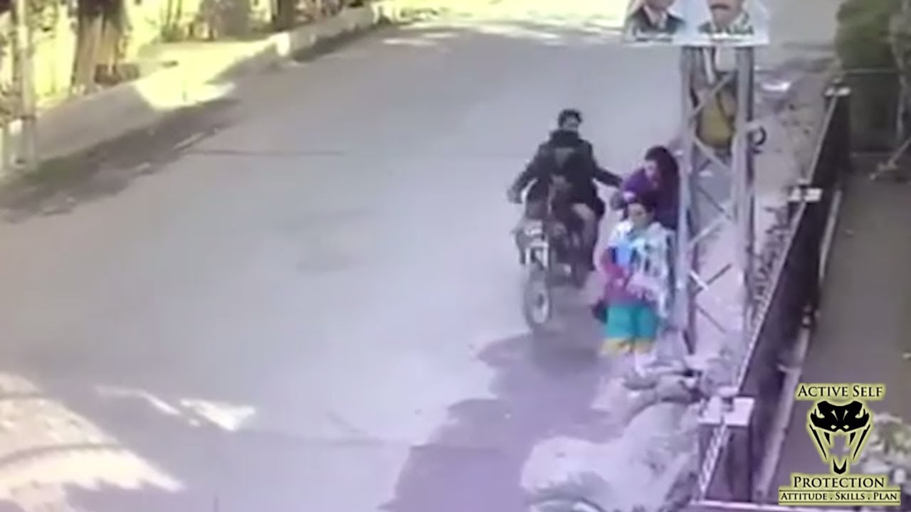 Woman Just Loses It After Moto Thieves Try to Steal Her Purse | Active Self Protection
