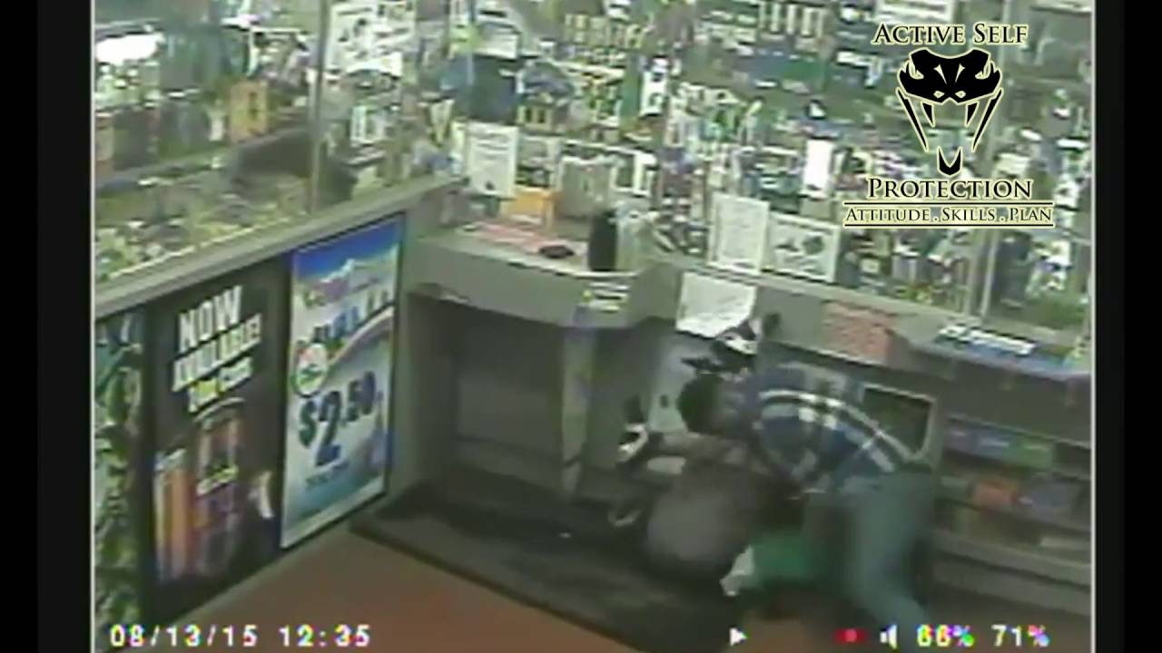 Caught on Camera  Man Loses Gun in Fight Against Armed Robber