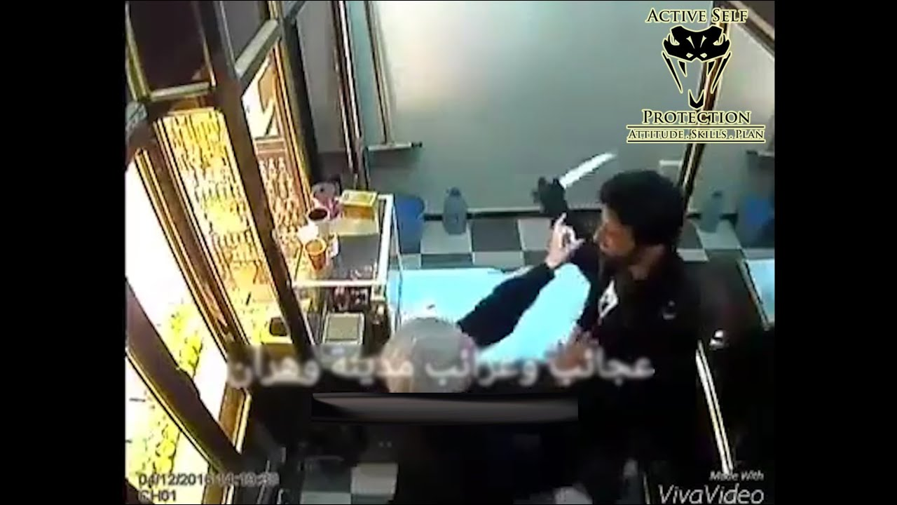 Determined Store Owner Beats Armed Robber
