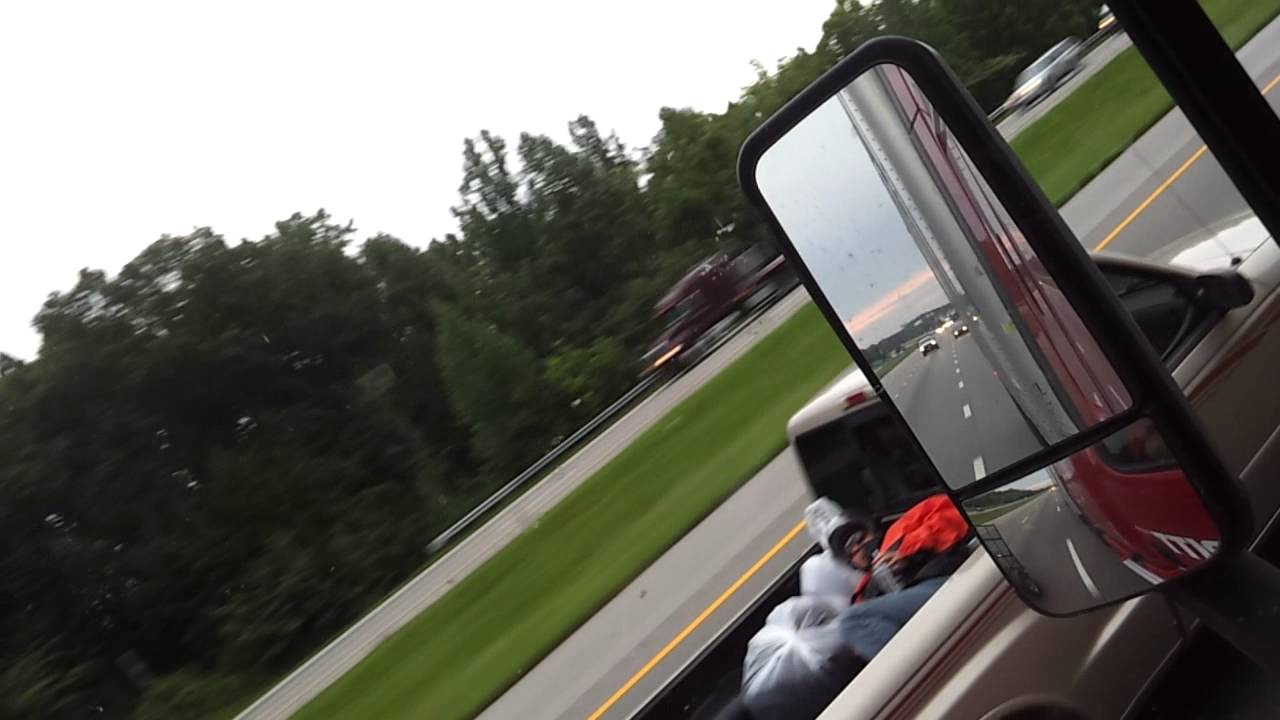 Motorcyclist sleeping? or dead? in bed of pickup