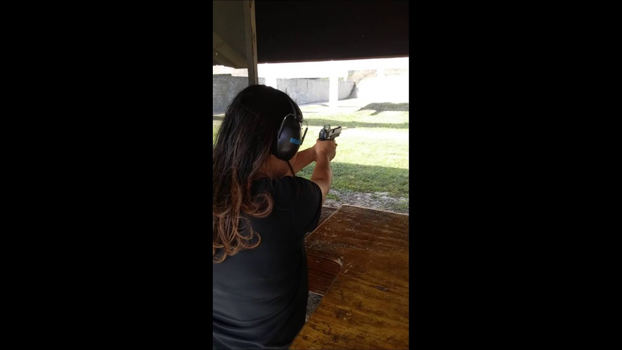 Wife shooting the M&P Performance Center CORE 40L