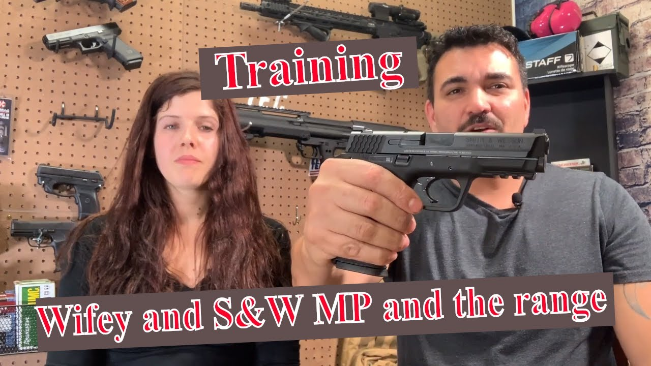 Training the wife on Smith and Wesson at the range shooting the gun