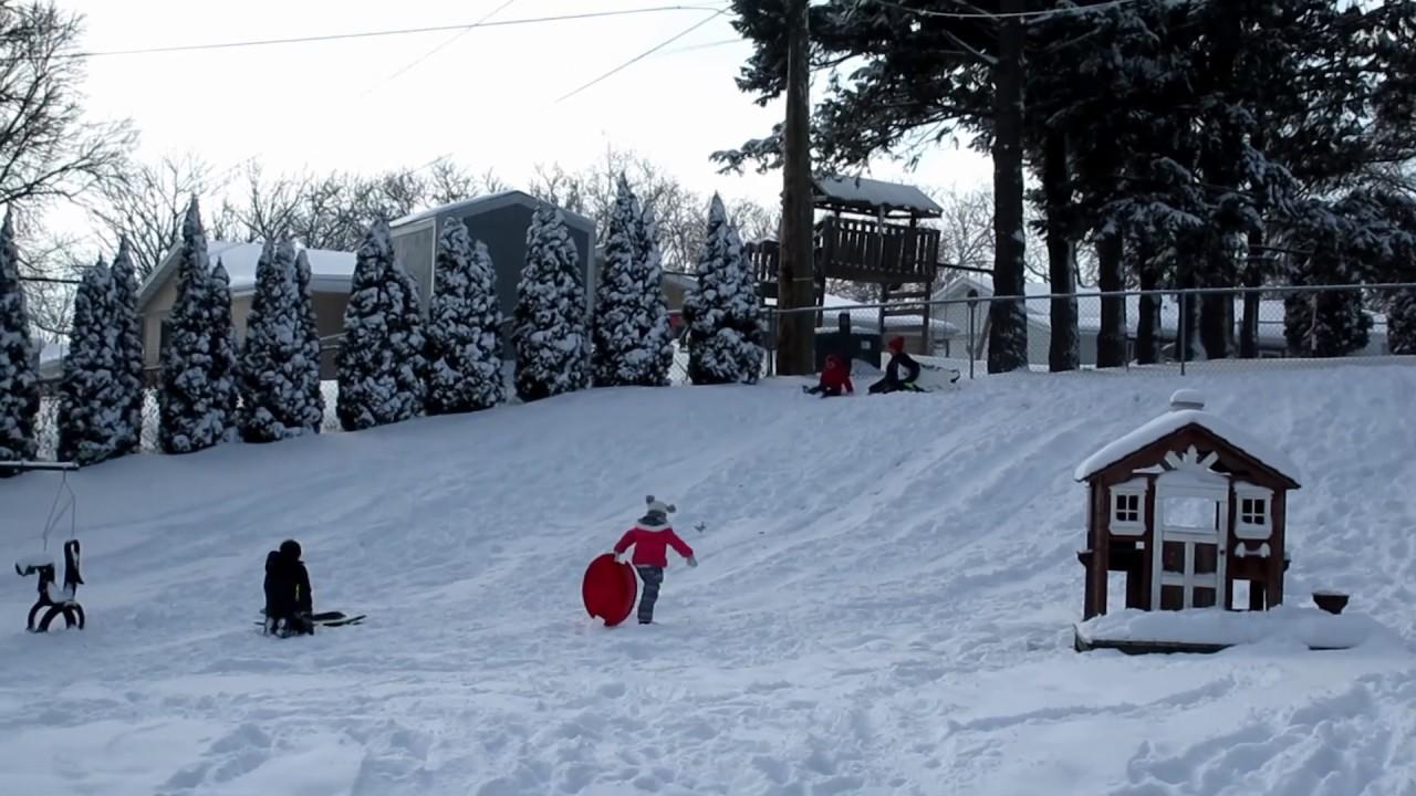 More sledding in the backyard