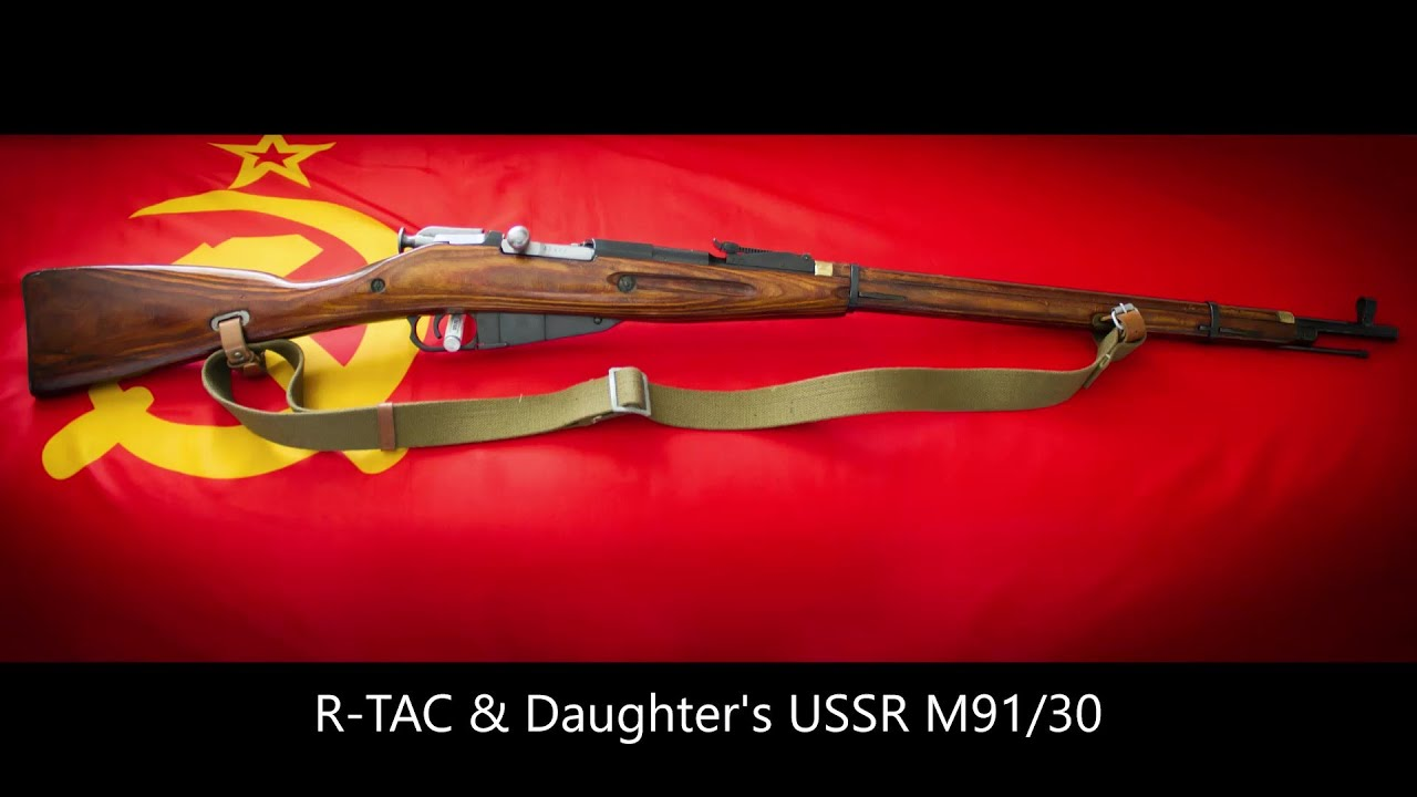 M91/30 USSR in between the war rifle.